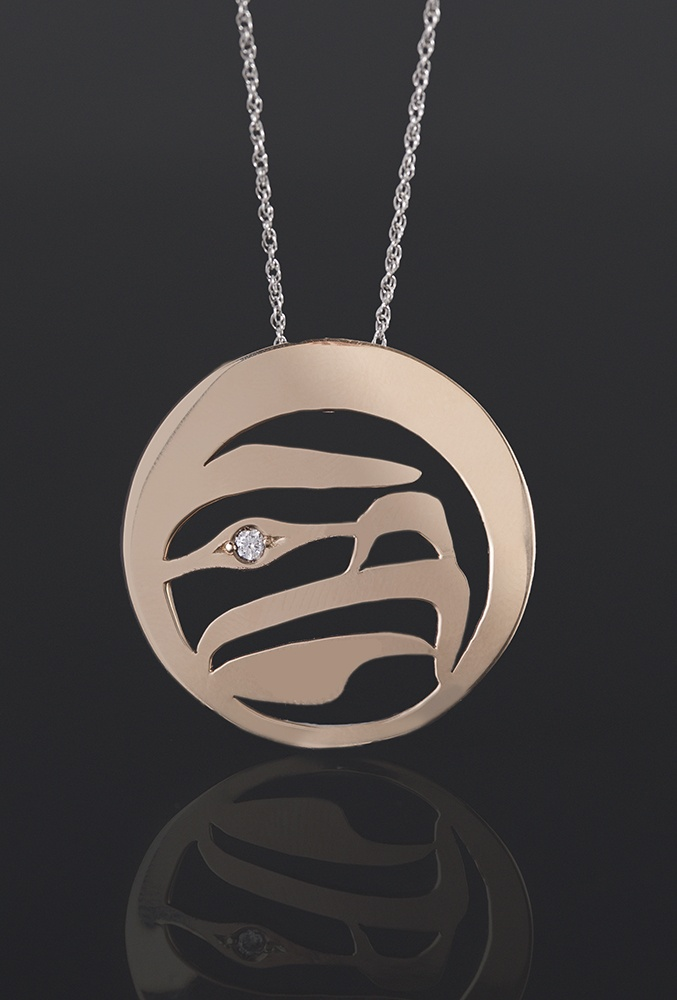 Eagle Eye pendant Grant Pauls Tahltan 18k gold 6pt diamond 1 1/4 dia. 1800 jewelry northwest coast native art
