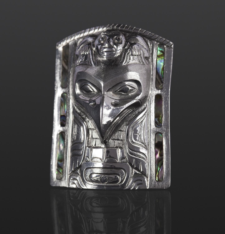 raven frontlet pendant Gus Cook Kwakwaka'wakw abalone silver Repoussé jewelry pendant native art northwest coast