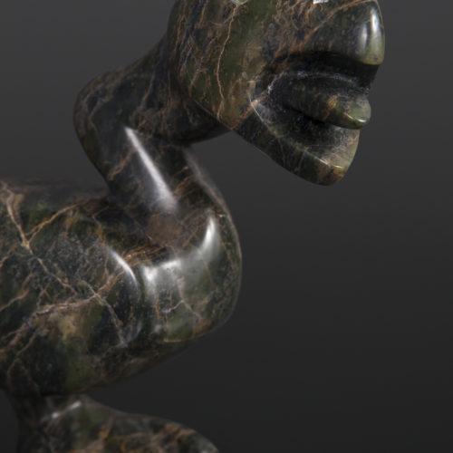 alerted bird Toonoo Sharky Inuit Serpentine bone, baleen 9x 6 ½ x 2¼ 1150 cape dorset sculpture inuit carving