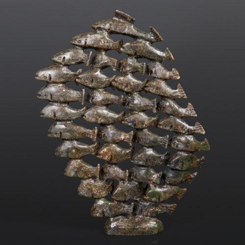 Pavinak Petaulassie Inuit Serpentine 10 x 13 x 1½ 1450 School of Fish inuit sculpture