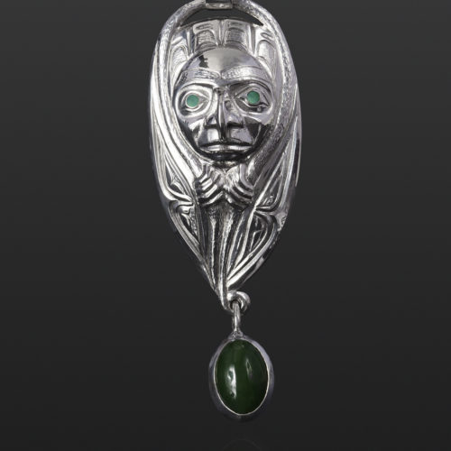 emergence pendant hawk transformation jade Gus Cook Kwakwaka'wakw abalone silver Repoussé jewelry pendant native art northwest coast