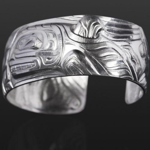 orca and thunderbird bracelet custom stand Gus Cook Kwakwaka'wakw silver Repoussé jewelry native art northwest coast 6 1/2 x 1 2600