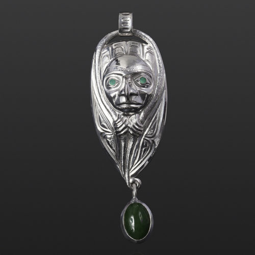 emergence pendant hawk transformation jade Gus Cook Kwakwaka'wakw abalone silver Repoussé jewelry pendant native art northwest coast 1950 3 1/4 x 1 1/4