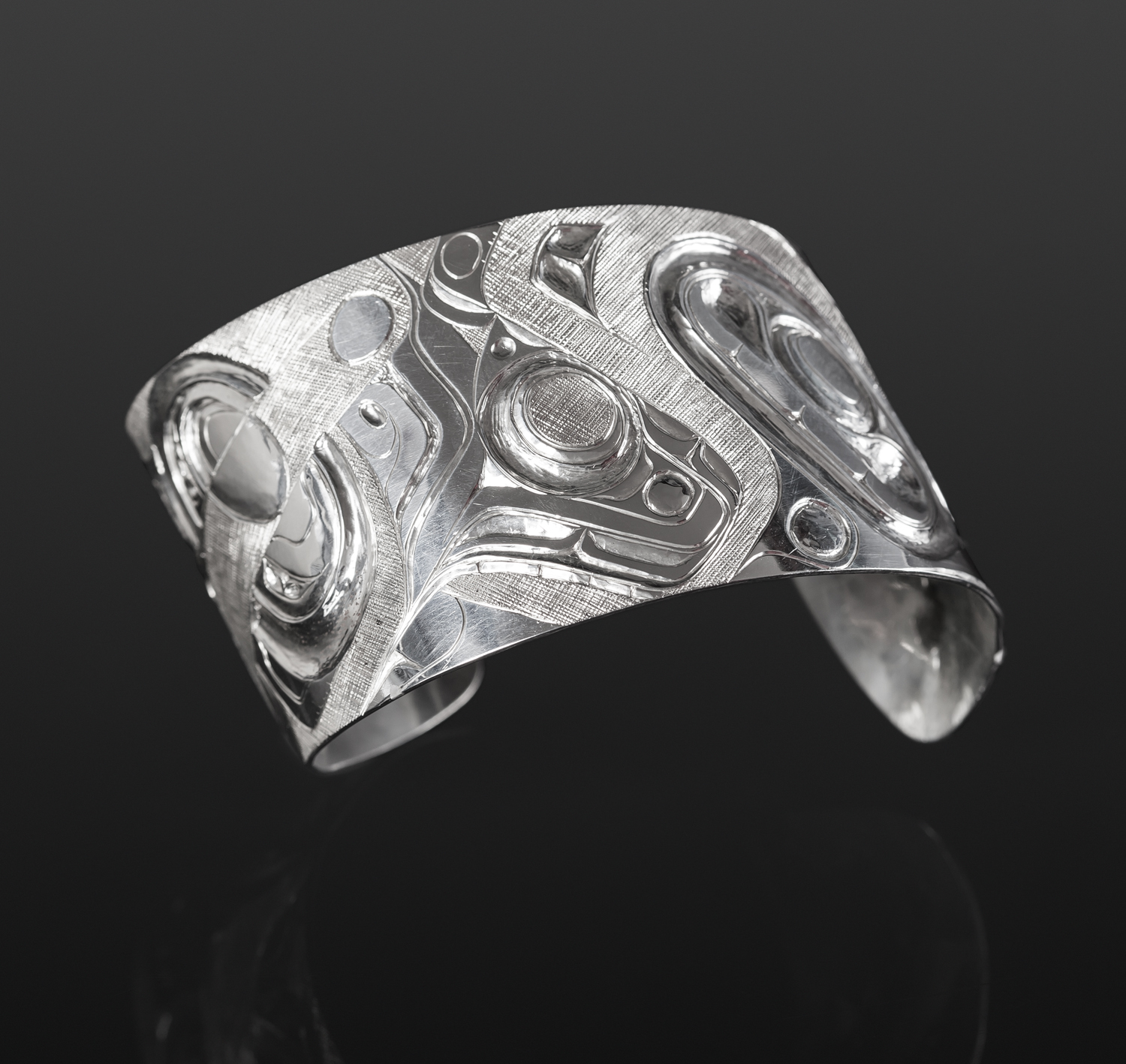 """Many Forms of Chamuos Marcel Russ Haida Silver, 1½"""" $3000"""