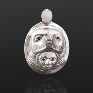 "Grizzly Bear Woman Gus Cook Kwakwaka'wakw Repousse silver, mother of pearl, garnet 2"" x 1½"" x ¾"""