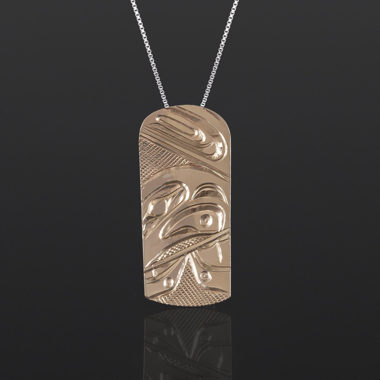 "Eagle Pendant Corrine Hunt Tlingit 14k gold 1"" x ½"" $495"