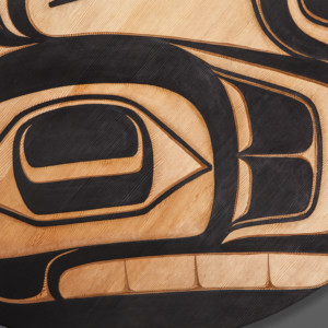 "Gaax Phil Gray Tsimshian  Red cedar, paint 38"" dia. x 2"""