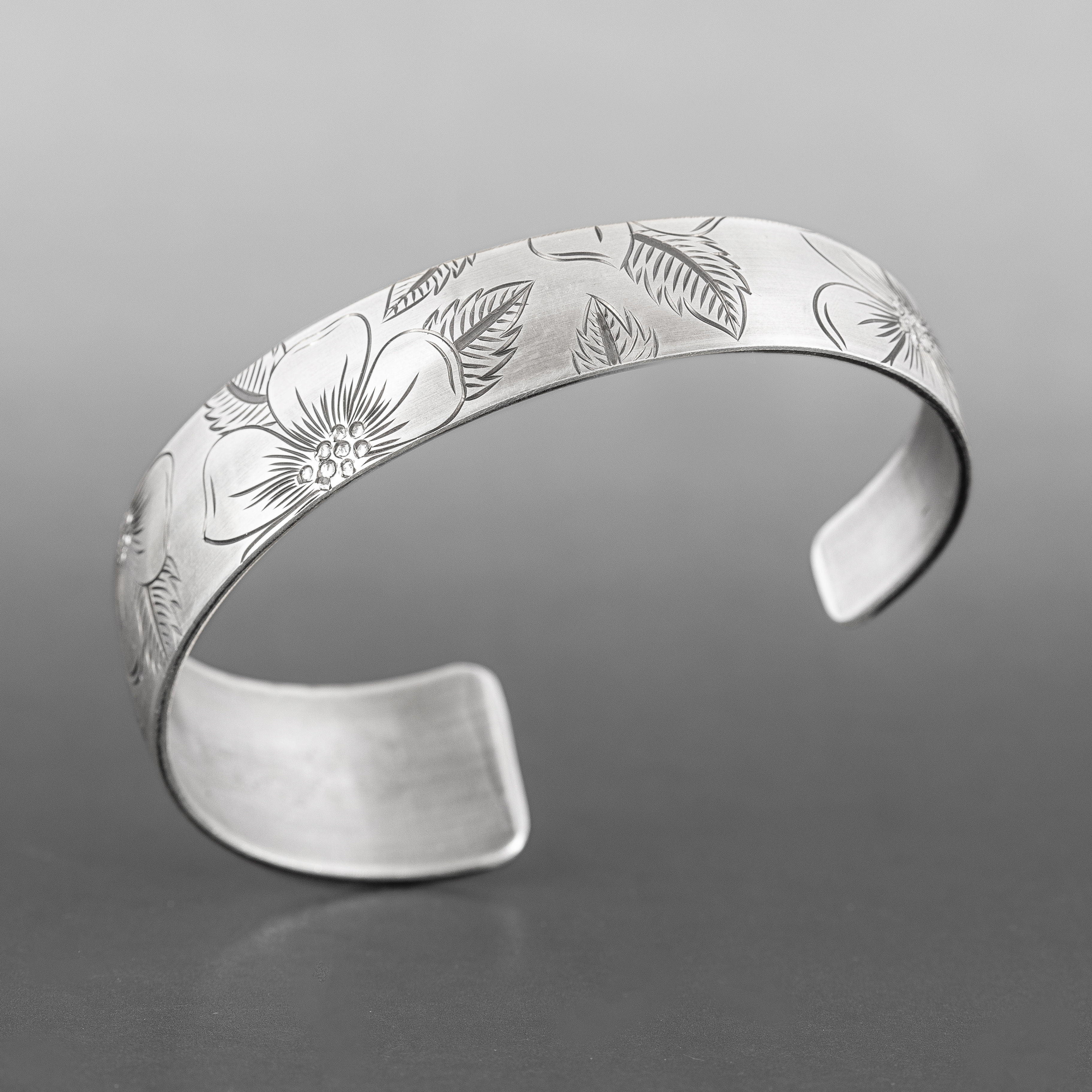 "Wild Rose Tapered Bracelet Jennifer Younger Tlingit  6"" x ¾"", 16 gauge  $325"