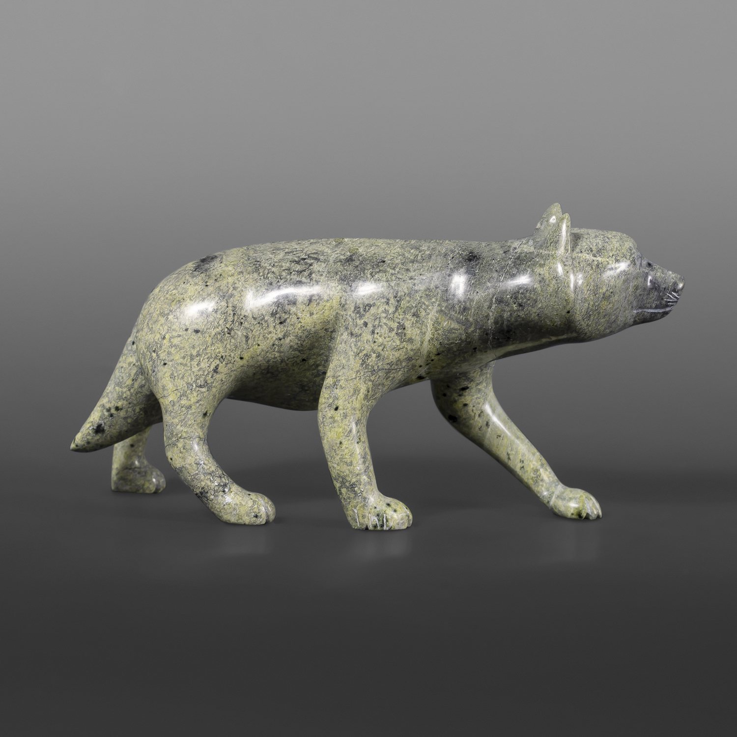 "Walking Wolf Mathew Flaherty Serpentine #61 7"" x 4"" x 2"" $950"