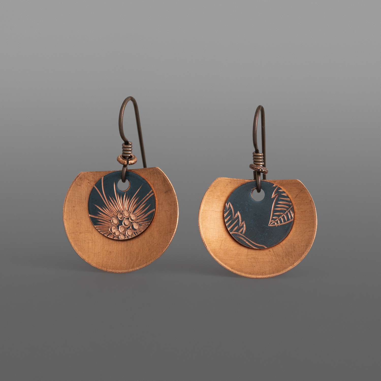 "Wildrose Disc Earrings Jennifer Younger Tlingit Patinated copper 1"" x ¾"" $160"