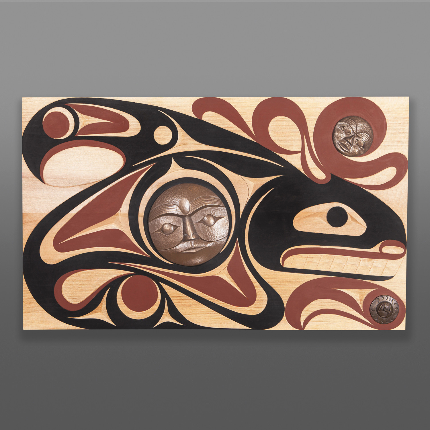 "Keeper of the Water Andy & Ruth Peterson Coast Salish Red cedar, cold-cast bronze, paint 36"" x 21½"" x 2"" $5800"