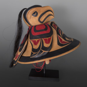 "Eagle Helmet Carol Young Bagshaw Haida Red cedar, leather, cord, horsehair, paint, custom stand 16"" x 15"" x 12"" (16"" tall with stand) $6000"