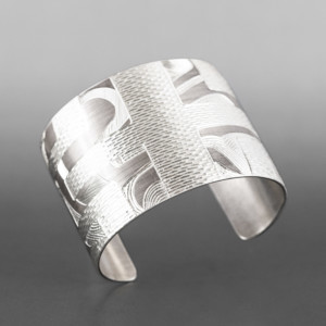 "Raven Weave Cuff  Jennifer Younger Tlingit  Silver 6"" x 2½""  $2200"