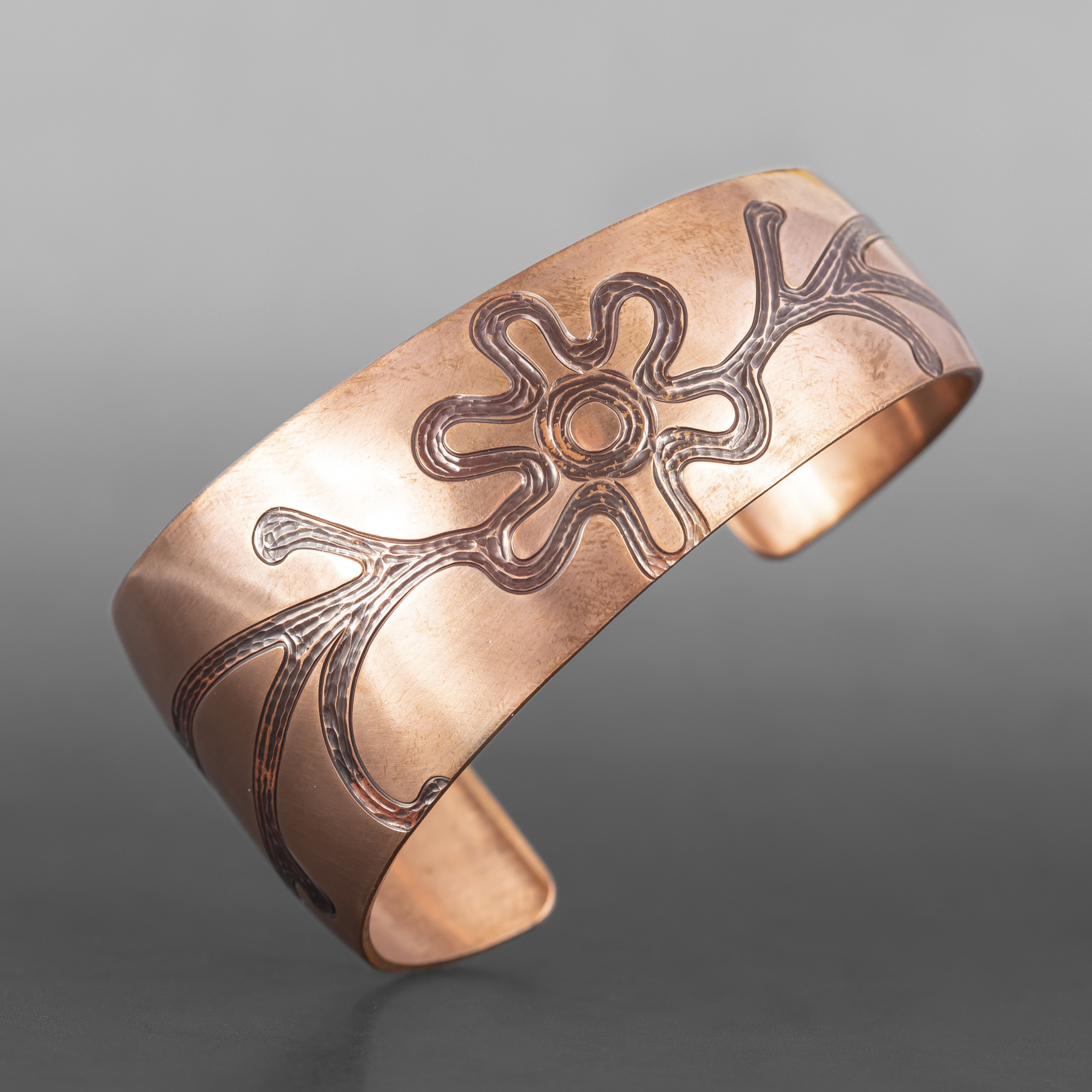 """Water is Life Bracelet Jennifer Younger Tlingit Tapered copper 6"""" x 1½"""" to ½"""" $400"""