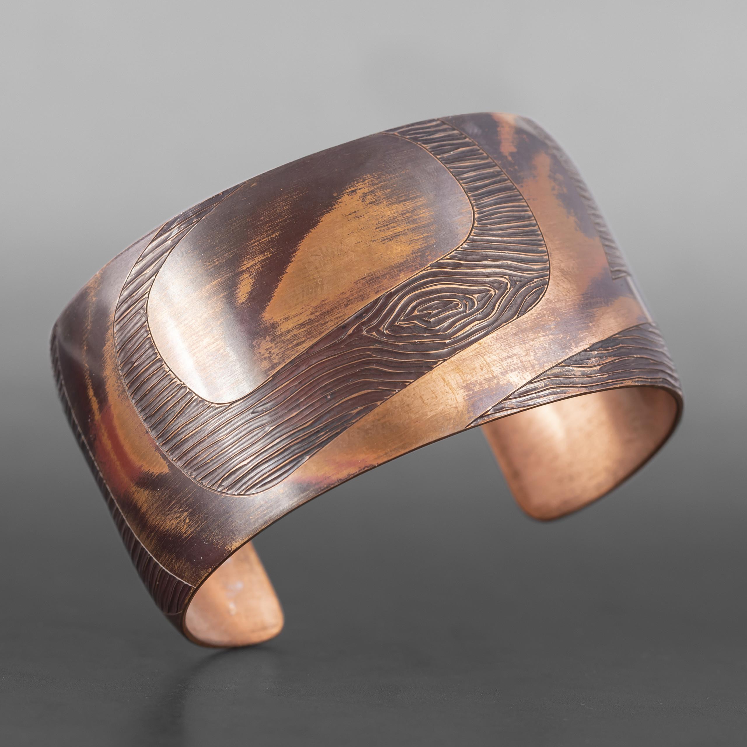 """Wood Grain Eagle Bracelet Jennifer Younger Tlingit Copper 6"""" x 1½"""" $550"""