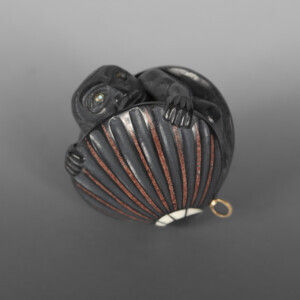 "Emergence of the First Man Pendant Christian White Haida Argillite, catlinite, ivory, abalone 1½"" x 1½"" 1"" $3800"