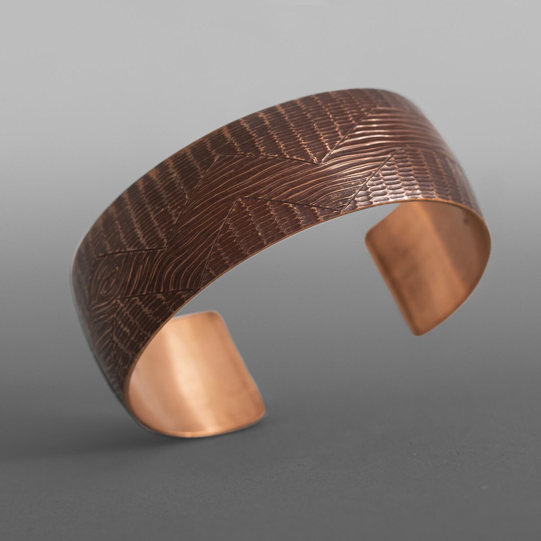 "People of the Land Bracelet Jennifer Younger Tlingit Heat-patinated copper 1"" x 6"" $600"