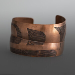 "'Raven Ties' Wood Grain Pattern Bracelet Set Jennifer Younger Tlingit Heat-patina copper 1"" tapering to ½"" x 6"" each $650"