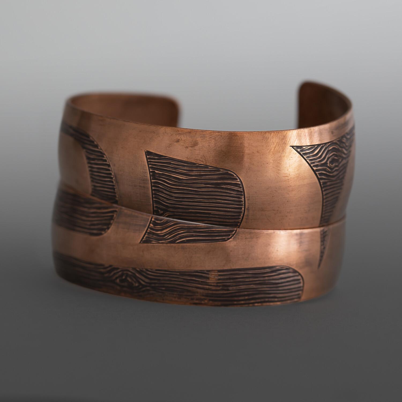 "'Raven Ties' Wood Grain Pattern Bracelet SetJennifer Younger TlingitHeat-patina copper 1"" tapering to ½"" x 6"" each$650"